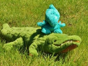 Herman rides on Gator McBumpypants' Head