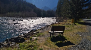 A bench by the river in Index, WA
