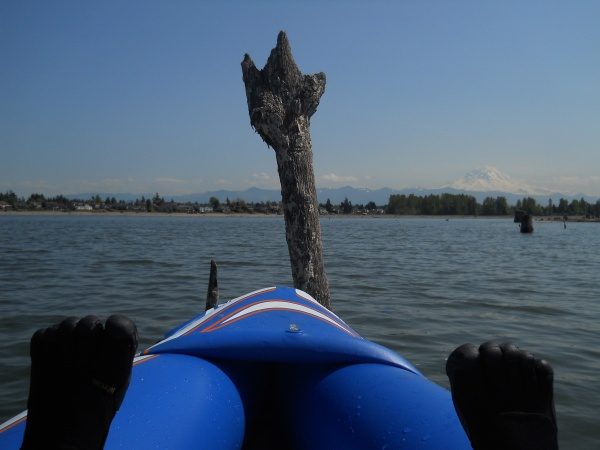 My feet in my inflatable kayak and an interesting stump in the lake