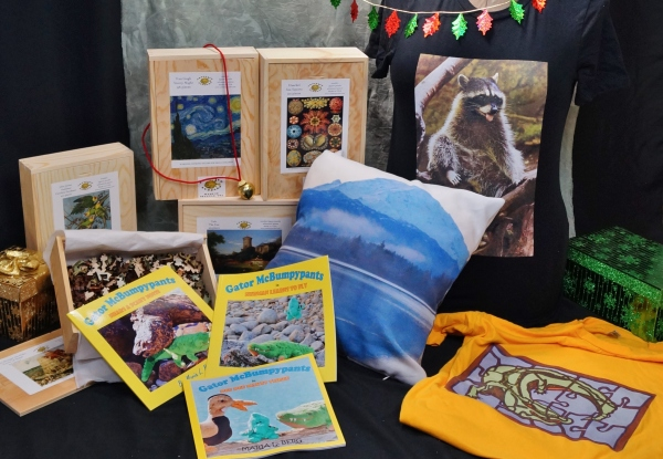 Pictured: Wooden jigsaw puzzles from Artifact Puzzles, Gator McBumpypants picturebooks and T-shirts and pillow cover from Red Bubble