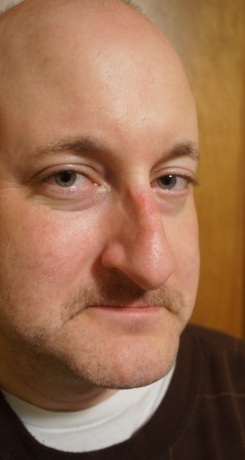 Man looking at camera with small amount of mustach growth