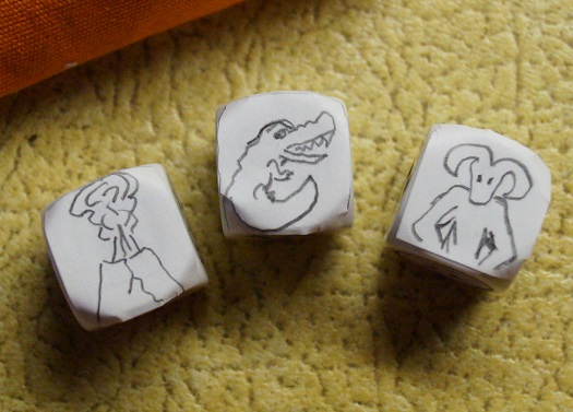 Three story cubes with hand-drawn symbols