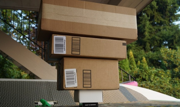 A photograph of large boxes stacked on smaller boxes