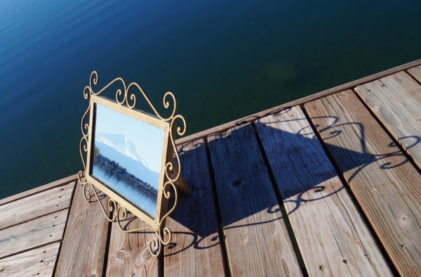 photograph of Mt. Rainier in a mirror on a dock on Lake Tapps