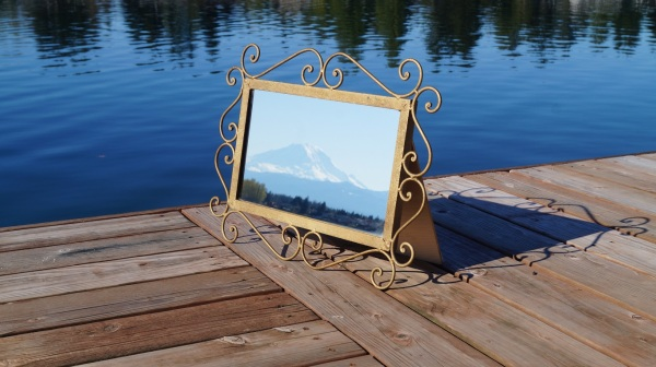 photograph of Mt. Rainier in a framed mirror