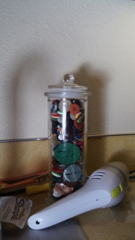 button jar and mini-vac with shadow of sink
